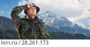 Купить «young soldier in military uniform over mountains», фото № 28261173, снято 14 августа 2014 г. (c) Syda Productions / Фотобанк Лори