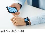 Купить «hands with smartphone and smart watch social media», фото № 28261381, снято 13 августа 2015 г. (c) Syda Productions / Фотобанк Лори