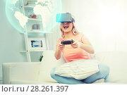 Купить «woman in virtual reality headset with controller», фото № 28261397, снято 30 апреля 2016 г. (c) Syda Productions / Фотобанк Лори
