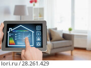 Купить «tablet pc with smart home settings on screen», фото № 28261429, снято 19 мая 2017 г. (c) Syda Productions / Фотобанк Лори