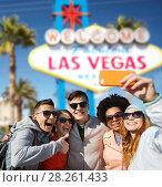 Купить «friends travelling to las vegas and taking selfie», фото № 28261433, снято 19 марта 2015 г. (c) Syda Productions / Фотобанк Лори
