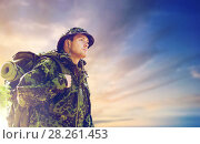 Купить «soldier in military uniform with backpack hiking», фото № 28261453, снято 14 августа 2014 г. (c) Syda Productions / Фотобанк Лори