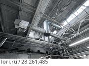 Купить «ventilation pipes at factory shop», фото № 28261485, снято 10 ноября 2017 г. (c) Syda Productions / Фотобанк Лори