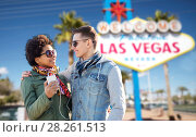 Купить «couple with smartphone and earphones at las vegas», фото № 28261513, снято 19 марта 2015 г. (c) Syda Productions / Фотобанк Лори