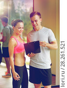 Купить «smiling young woman with personal trainer in gym», фото № 28261521, снято 29 июня 2014 г. (c) Syda Productions / Фотобанк Лори