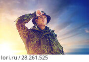 Купить «young soldier in military uniform over sky», фото № 28261525, снято 14 августа 2014 г. (c) Syda Productions / Фотобанк Лори
