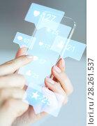 Купить «hands with social media icons on smartphone», фото № 28261537, снято 13 августа 2015 г. (c) Syda Productions / Фотобанк Лори