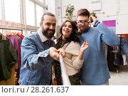 Купить «friends taking selfie at vintage clothing store», фото № 28261637, снято 30 ноября 2017 г. (c) Syda Productions / Фотобанк Лори