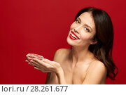 beautiful woman with red lipstick holding diamond. Стоковое фото, фотограф Syda Productions / Фотобанк Лори