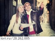 Купить «Smiling couple man and woman with map», фото № 28262005, снято 18 ноября 2017 г. (c) Яков Филимонов / Фотобанк Лори