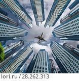 Купить «Plane encircled by buildings», фото № 28262313, снято 19 октября 2018 г. (c) Яков Филимонов / Фотобанк Лори