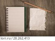 Купить «Crumpled pages and notebook», фото № 28262413, снято 25 апреля 2018 г. (c) Яков Филимонов / Фотобанк Лори