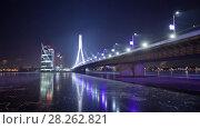 Купить «Night Riga city winter timelapse, lights, bridge, Daugava river», видеоролик № 28262821, снято 28 ноября 2017 г. (c) Aleksejs Bergmanis / Фотобанк Лори