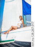 Купить «woman in fashion white swimsuit sitting on yacht», фото № 28267017, снято 25 июля 2017 г. (c) katalinks / Фотобанк Лори