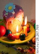 Купить «Кулич и разноцветные яйца. Пасхальный натюрморт. Кекс, окрашенные яйца и две свечи.», фото № 28267769, снято 5 апреля 2018 г. (c) ирина реброва / Фотобанк Лори