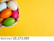 Купить «Easter eggs on a yellow table», фото № 28273089, снято 17 марта 2018 г. (c) Иван Карпов / Фотобанк Лори