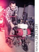 Worker practicing his skills with plough at workplace. Стоковое фото, фотограф Яков Филимонов / Фотобанк Лори