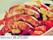 Купить «Grilled sausages and vegetables», фото № 28273601, снято 22 марта 2019 г. (c) Яков Филимонов / Фотобанк Лори