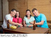 Купить «happy four friends while playing poker at the table», фото № 28273821, снято 15 июня 2016 г. (c) Константин Лабунский / Фотобанк Лори