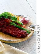 Delicious pork ribs seasoned with a spicy sauce. Стоковое фото, фотограф Alexander Tihonovs / Фотобанк Лори