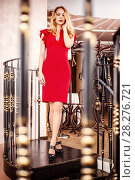 Купить «Beautiful blond woman red close-fitting dress», фото № 28276721, снято 8 апреля 2017 г. (c) katalinks / Фотобанк Лори