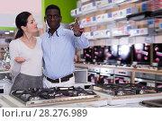 Купить «Nice couple chooses cooktop in store», фото № 28276989, снято 21 февраля 2018 г. (c) Яков Филимонов / Фотобанк Лори