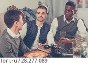 Купить «Males friendly meeting over beer», фото № 28277089, снято 23 февраля 2018 г. (c) Яков Филимонов / Фотобанк Лори