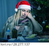Купить «Girl in a plaid is ill of virus in the New Year night», фото № 28277137, снято 6 января 2018 г. (c) Яков Филимонов / Фотобанк Лори