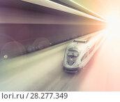 Купить «Speed of train traveling», фото № 28277349, снято 4 марта 2013 г. (c) Яков Филимонов / Фотобанк Лори