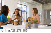 Купить «happy businesswomen eating take out food at office», видеоролик № 28278185, снято 26 марта 2018 г. (c) Syda Productions / Фотобанк Лори