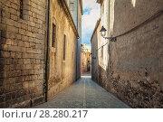Купить «Old narrow street view of medieval Girona. Catalonia, Spain», фото № 28280217, снято 15 октября 2018 г. (c) Сергей Цепек / Фотобанк Лори