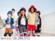 Купить «Group of happy sporty kids rollerblading outdoors», фото № 28280513, снято 14 октября 2017 г. (c) Сергей Новиков / Фотобанк Лори