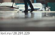 Купить «Worker remove foam and water with a MOP after car washing», фото № 28291229, снято 20 июля 2018 г. (c) Константин Шишкин / Фотобанк Лори