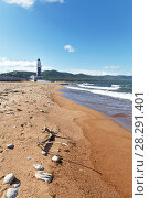 Купить «Baikal Lake. View of the lighthouse near the entrance to the Baikal Harbor from a sandy beach near the village of Turka on a summer day», фото № 28291401, снято 26 августа 2016 г. (c) Виктория Катьянова / Фотобанк Лори