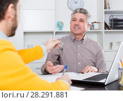 Купить «Mature man and agent sign rental agreement», фото № 28291881, снято 16 июля 2018 г. (c) Яков Филимонов / Фотобанк Лори