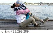 Купить «A woman sits on the front seat with a child and play», видеоролик № 28292289, снято 17 октября 2017 г. (c) Tatiana Kravchenko / Фотобанк Лори