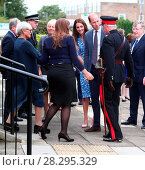 Купить «The Duke and Duchess of Cambridge visit the Stewards Academy in Harlow, Essex. Prince William helps Essex Lord Lieutenant Jonathan Douglas-Hughes after...», фото № 28295329, снято 16 сентября 2016 г. (c) age Fotostock / Фотобанк Лори