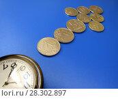 Купить «Время – деньги. Часы и монеты в виде стрелки.», фото № 28302897, снято 4 апреля 2018 г. (c) ViktoriiaMur / Фотобанк Лори