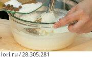 Купить «The cook whips the cheese mass with a blender», видеоролик № 28305281, снято 5 декабря 2016 г. (c) Tatiana Kravchenko / Фотобанк Лори