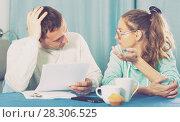 Купить «Couple struggling to pay bills», фото № 28306525, снято 18 марта 2017 г. (c) Яков Филимонов / Фотобанк Лори