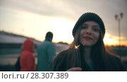 Купить «Happy young woman with sparkler at sunset outdoors», видеоролик № 28307389, снято 24 апреля 2018 г. (c) Константин Шишкин / Фотобанк Лори