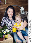 Купить «Mom and child are planting flowers», фото № 28307697, снято 14 апреля 2018 г. (c) Типляшина Евгения / Фотобанк Лори