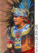 Купить «An Aztec dancer during a ceremony in the Zocalo in Mexico City», фото № 28309245, снято 11 декабря 2019 г. (c) BE&W Photo / Фотобанк Лори
