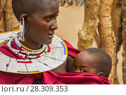 Купить «Portrait of a Maasai Woman from Kenya with Colorful African Bead Necklace Jewelry around her Neck», фото № 28309353, снято 15 июля 2018 г. (c) BE&W Photo / Фотобанк Лори