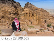 Купить «Bedouin looking on the ornate carved rock tomb known as The Monastery El Deir Nabataean ancient town Petra Jordan», фото № 28309565, снято 26 июня 2019 г. (c) BE&W Photo / Фотобанк Лори