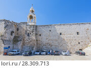 Купить «The Church of the Nativity in Manger Square, Bethlehem, Palestine. It takes its name from the manger where Jesus is said to have been born which, according to Christian tradition, took place at the Nativity Church.», фото № 28309713, снято 23 октября 2019 г. (c) BE&W Photo / Фотобанк Лори