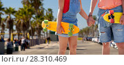 Купить «couple with skateboards at venice beach in la», фото № 28310469, снято 19 июля 2016 г. (c) Syda Productions / Фотобанк Лори