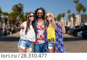 Купить «hippie friends showing peace at venice beach in la», фото № 28310477, снято 27 августа 2015 г. (c) Syda Productions / Фотобанк Лори