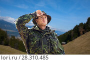 Купить «young soldier in military uniform outdoors», фото № 28310485, снято 14 августа 2014 г. (c) Syda Productions / Фотобанк Лори
