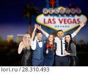 Купить «happy friends with party props posing at las vegas», фото № 28310493, снято 3 марта 2018 г. (c) Syda Productions / Фотобанк Лори